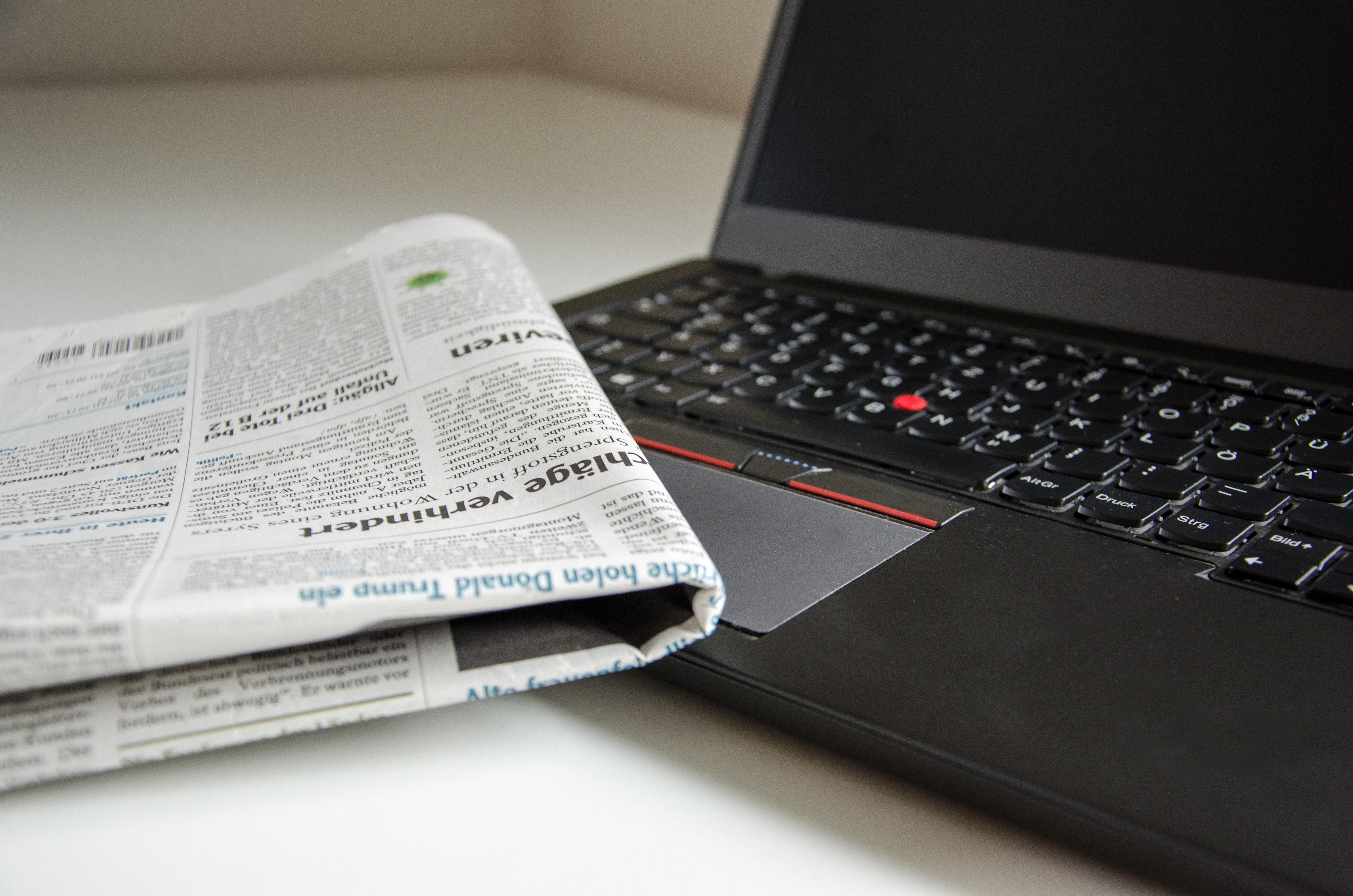 Laptop and newspaper