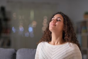 arab woman breathing in fresh indoor air
