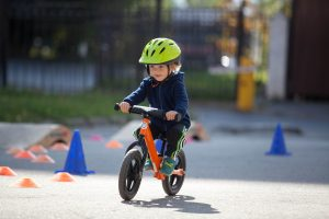 young child on bike wearing helmet